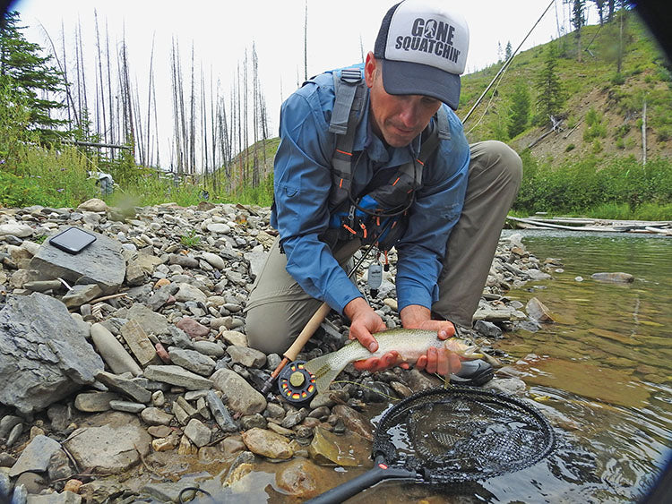 A.J. Johnson releases a nice cutthroat. The trout would take hopper imitations, but ant patterns seemed to be the best bet.