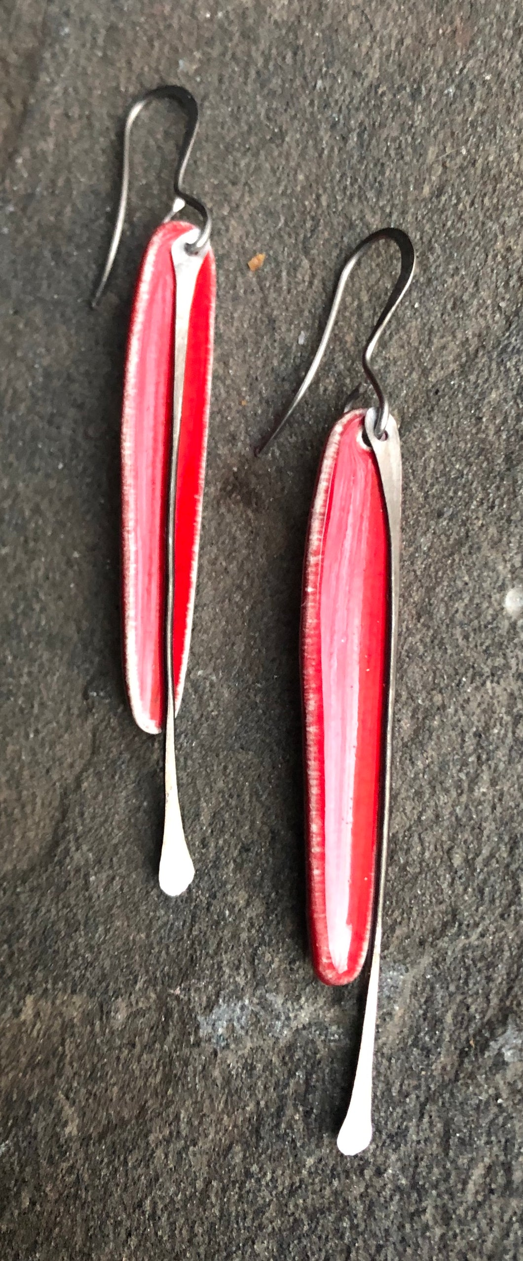handmade long dangly red ceramic spear shaped lightweight hypoallergenic statement earrings with black tassel