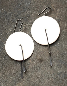 handmade white ceramic lightweight hypoallergenic circle statement earrings with black steel center tassel