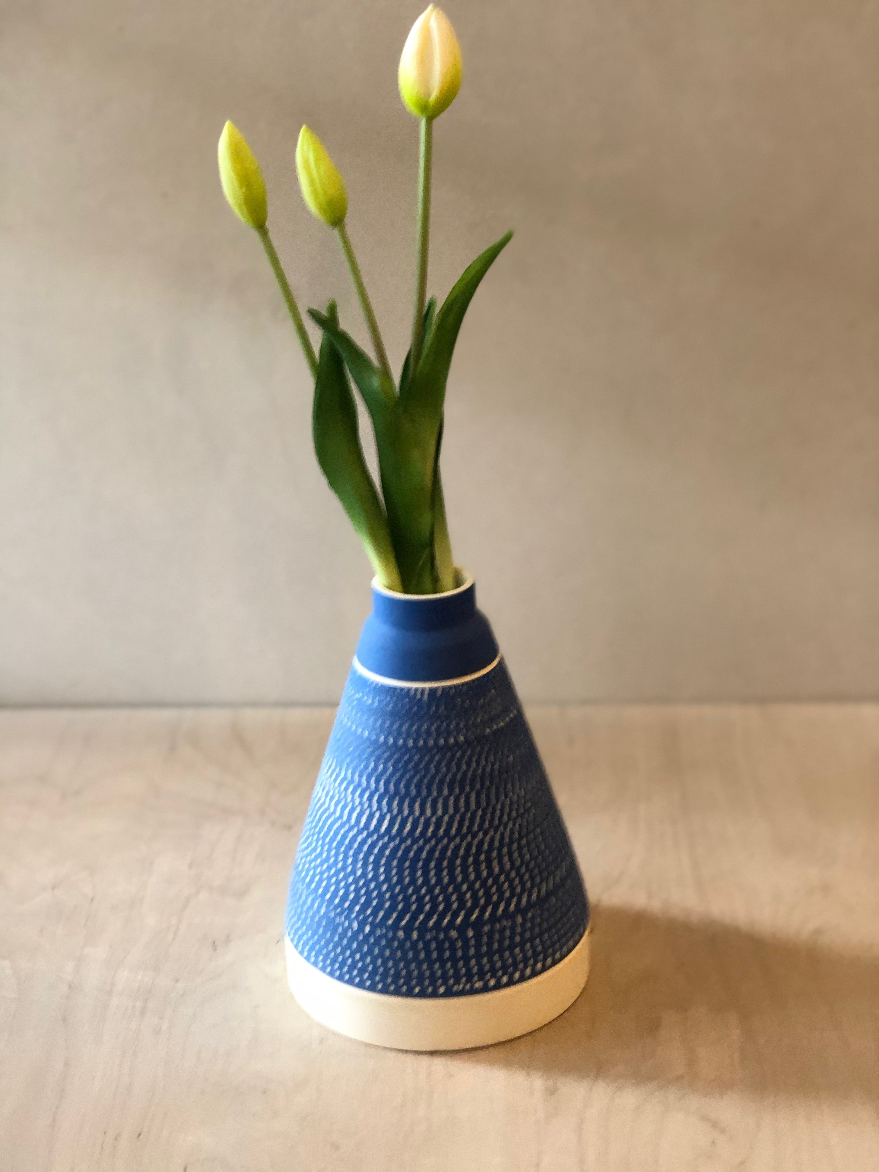 Tall Grey pyramid vase with chattering decoration