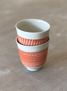 Porcelain cup with chattering decoration /  Orange