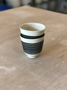 Porcelain cup with chattering decoration /  Yellow