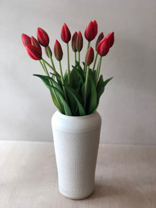 Big white vase with chattering decoration
