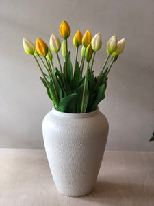 Large white vase with chattering decoration