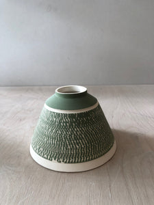 Small green pyramid vase with chattering decoration