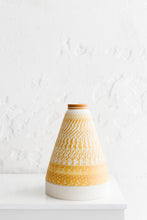 Tall ochre pyramid vase with chattering decoration