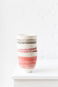 Porcelain cup with chattering decoration / Ocher