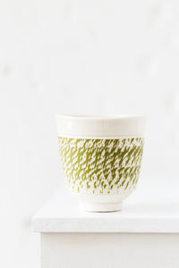 Porcelain cup with chattering decoration /  Green
