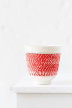Porcelain cup with chattering decoration / True red