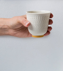 Porcelain cup with chattering decoration / Mustard yellow