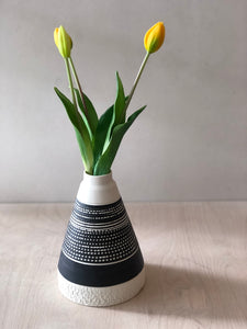 Tall Black pyramid vase with chattering decoration