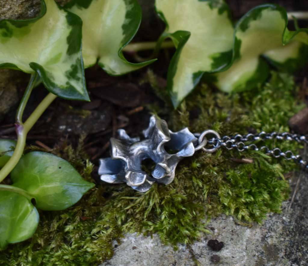 cast double vertebrae pendant