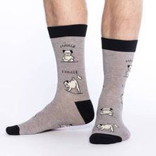 Load image into Gallery viewer, Men's feet in gray and black socks with funny pictures of yoga dog