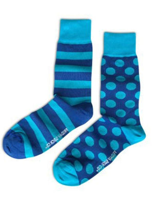 Blue mismatched socks with dots and stripes