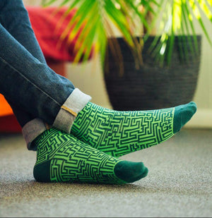 Feet in green stripes socks