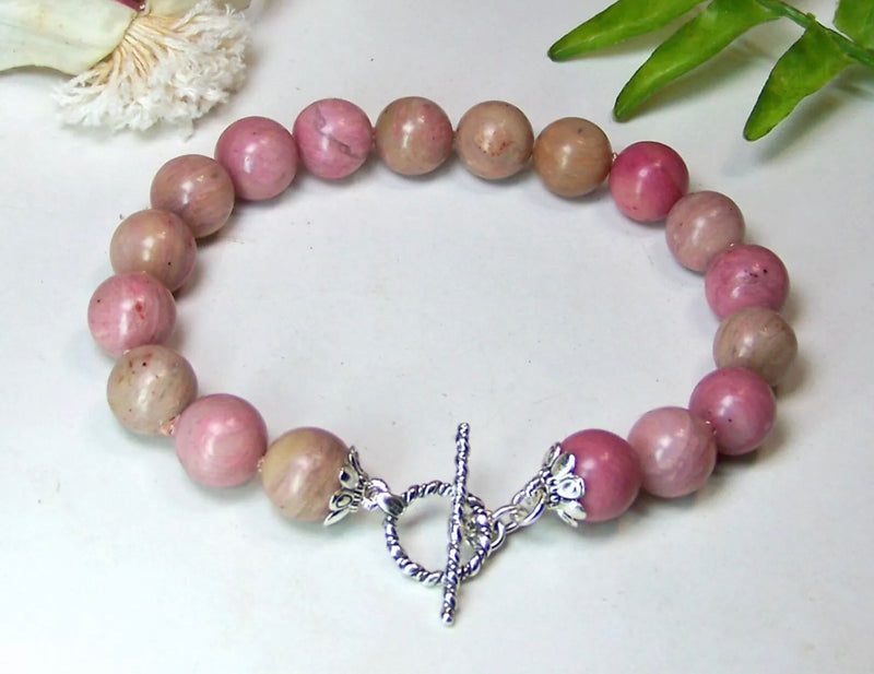Rhodochrosite is the Pink Crystal that Manages the Heart - Pisces Secrets LLC