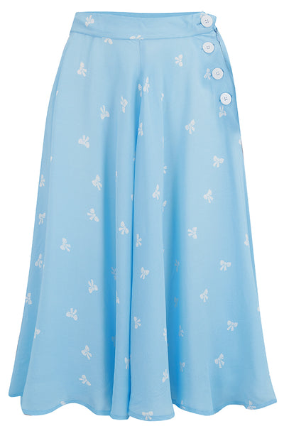 "The Seamstress Of Bloomsbury ""Isabelle"" Skirt in Powder Blue With Bow Print, Classic & Authentic 1940s Vintage Inspired Style - RocknRomance Clothing"