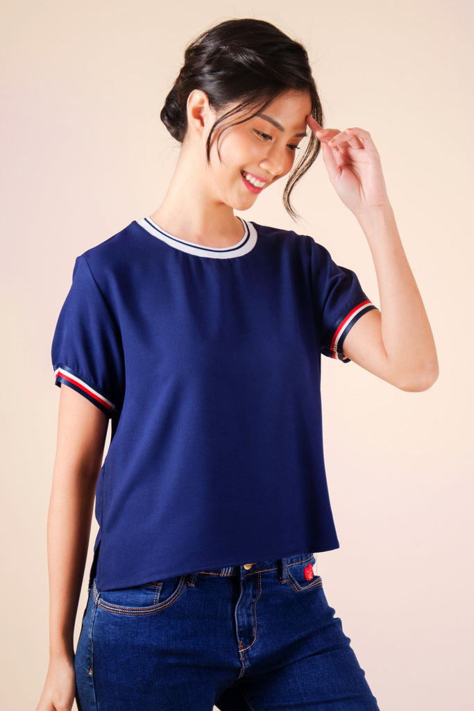WB-EMERY-NAVY-FRONT Short -sleeves round neck cropped blouse with flat knit combi on neckline and stripes details on sleeves