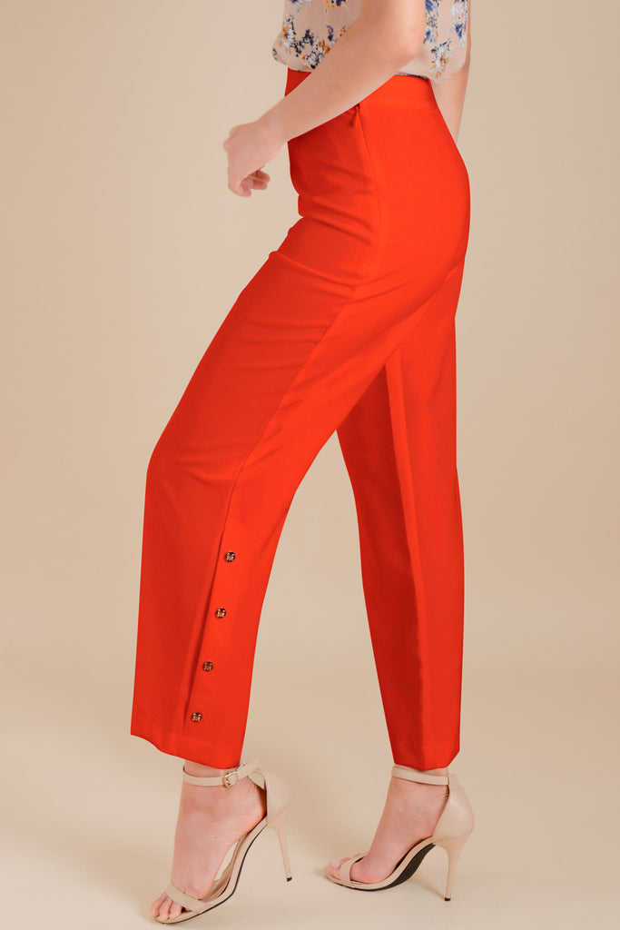 WP-DRIZZLE-RED-SIDE Long pants with side zipper & button details on hem