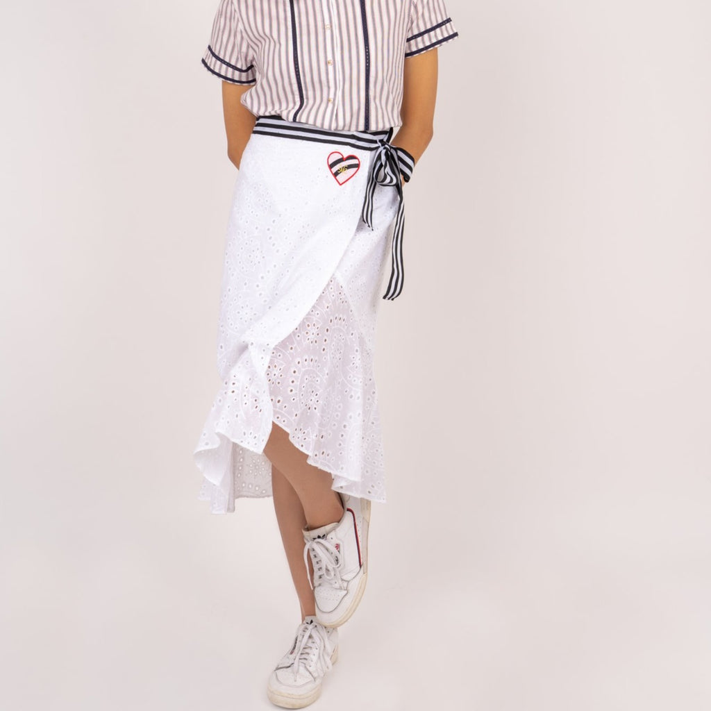 WS-VICTORIA-WHITE-FRONT Below the knee wrap around skirt with stripes belt and heart patch detail
