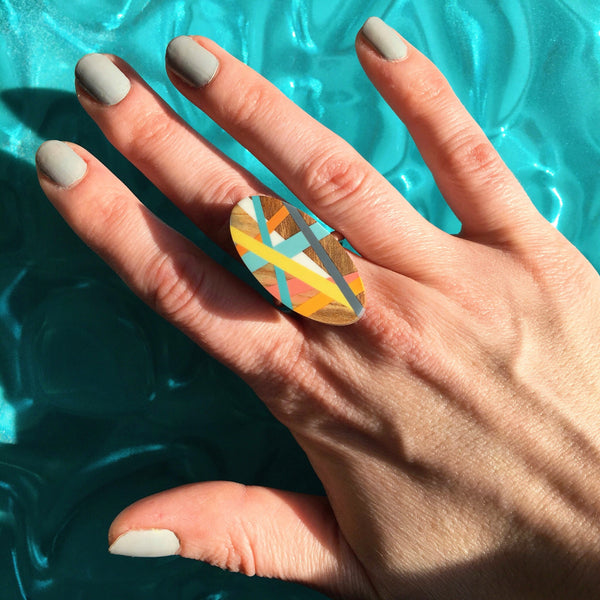 Laura Jaklitsch Jewelry Wood x Polyurethane Meyer Lemon Ring Yellow Grey Pink Orange One of a Kind Handmade Beach Surf Summer Style