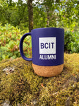 blue mug, BCIT alumni logo, cork base