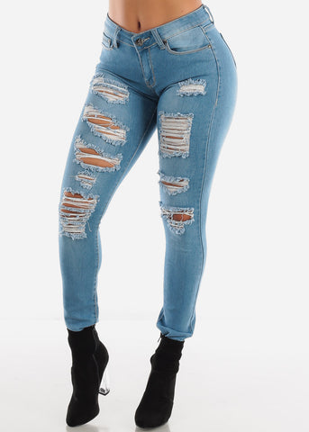 Image of Mid Rise Light Wash Ripped Skinny Jeans