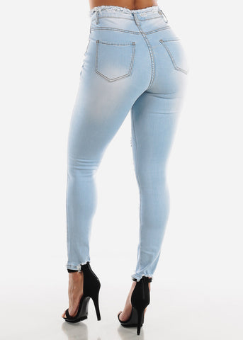 Image of Torn Light Wash Skinny Jeans