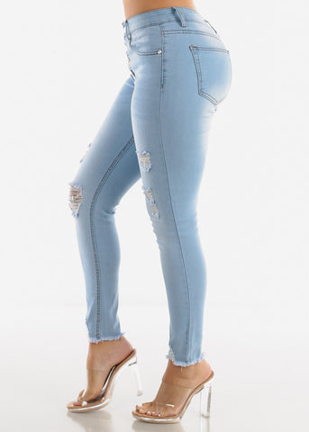 Button Up Torn Light Wash Skinny Jeans