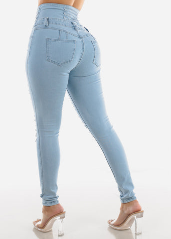 Image of Light Wash Torn High Rise Corset Skinny Jeans