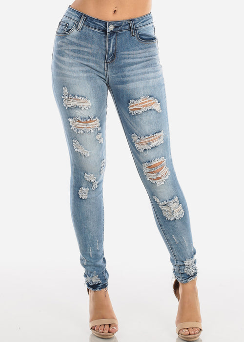 Ripped Mid Rise Whiskered Skinny Jeans