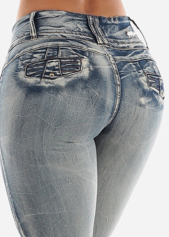 Image of Mid Rise Levanta Cola Faded Skinny Jeans