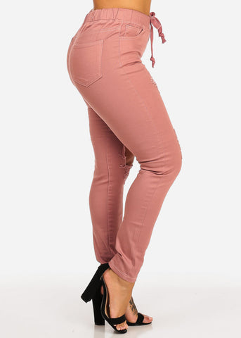 Image of Pink Mid Rise Distressed Skinny Jeans