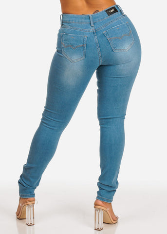 Mid Rise Light Wash Distressed Skinny Jeans