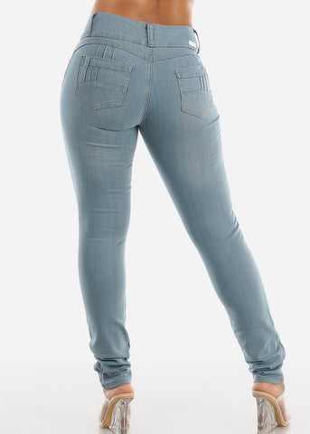 Image of Light Wash Mid Rise Levanta Cola Skinny Jeans