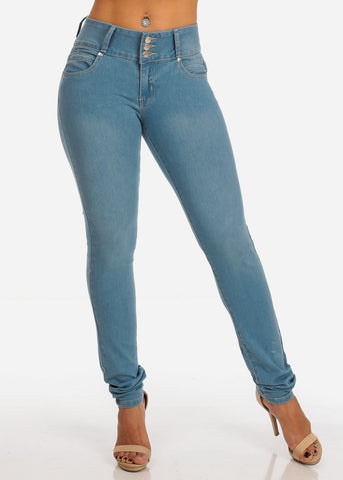 Image of Mid Rise Light Wash Levanta Cola 3 Button Skinny Jeans