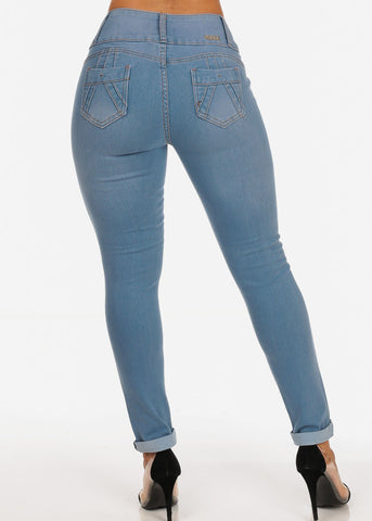 Image of Distressed Butt Lifting Light Wash 3 Button Mid Rise Ankle Skinny Jeans