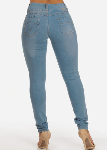 Image of Light Wash Levanta Cola Mid Rise 3 Button Skinny Jeans