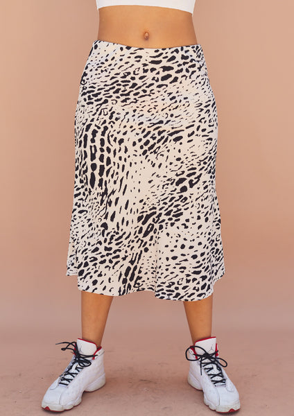 Animal print, cream and black, midi skirt with hidden smooth elastic waistband.
