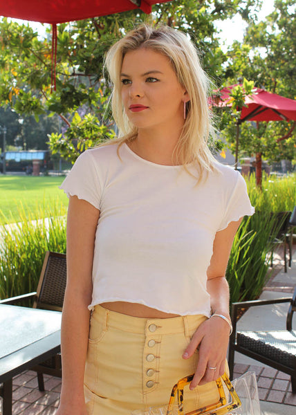 Fitted white tshirt with scalloped hem on sleeves and bottom
