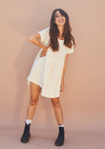 Ivory linen, short sleeve babydoll mini dress.