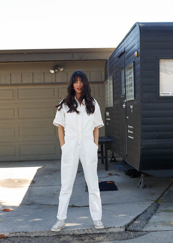 oversized white short sleeve coverall. street style