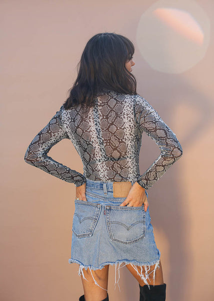 Snakeskin print long sleeve bodysuit with button enclosure, mesh material