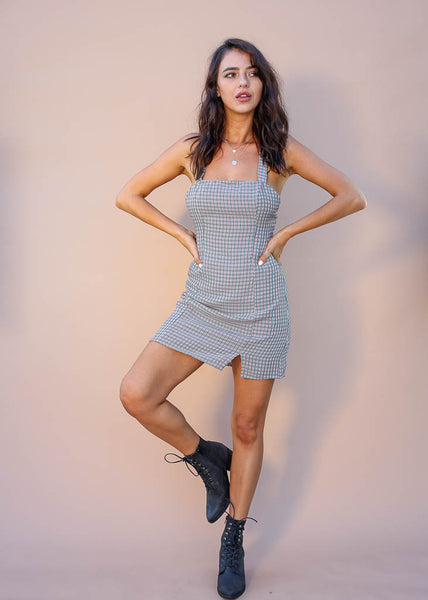 Plaid mini dress with small leg slit and criss cross straps . Hidden back zipper.