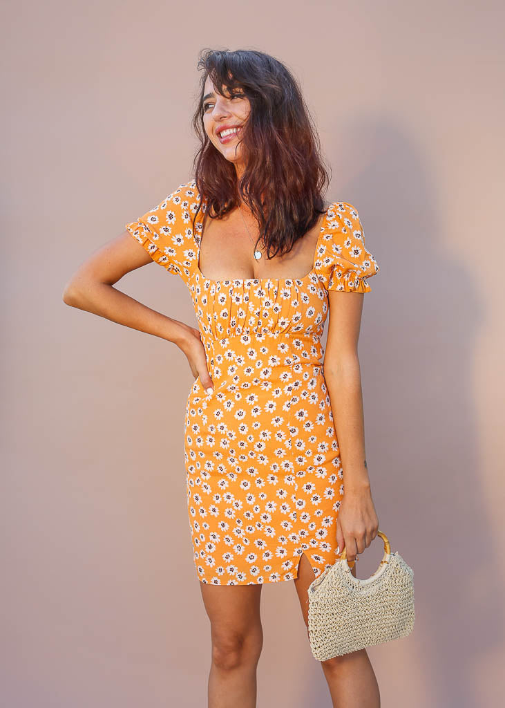 Tangerine floral mini with ruffle puff sleeve, ruched top, small leg slit and smocked backside