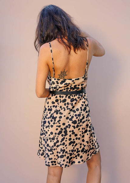 Cowl neck spotted slip dress with adjustable spaghetti straps.