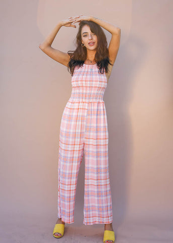 Cutest pastel plaid jumpsuit with smocked top, button closure in back, wide leg plants and POCKETS!