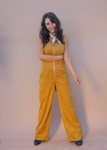 Camel faux corduroy jumpsuit. Exposed silver front zipper. Wear it alone or pair with a tshirt or bodysuit.