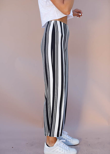 Black and white stretchy, wide legged cropped pants. Hidden elastic waistband