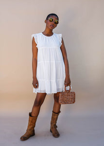 White mini dress with a high neck and tiered sleeves with ruffle detail. Summer and Spring Dress